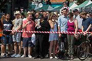 Visitors to the Lambeth Show in Herne Hill, are controlled by tape and barriers, on 21st July, in London, England.
