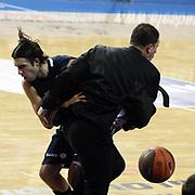Anadolu Efes's Sasha VUJACIC (L) during their Turkish Airlines Euroleague Basketball Group C Game 6 match Anadolu Efes between Partizan at Sinan Erdem Arena in Istanbul, Turkey, Wednesday, November 23, 2011. Photo by TURKPIX