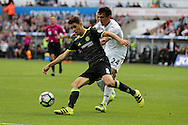 Oscar of Chelsea breaks away from Jack Cork of Swansea city. Premier league match, Swansea city v Chelsea at the Liberty Stadium in Swansea, South Wales on Sunday 11th Sept 2016.<br /> pic by  Andrew Orchard, Andrew Orchard sports photography.