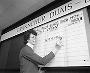 Prize Bonds Draw      (J26).1975..02.04.1975.04.02.1975.2nd April 1975..The first monthly draw held under the terms of the new prospectus of the prize bonds was held at the prize bond office, Bank of Ireland, 33-41 Lower Mount Street, Dublin..In this draw and future draws a new prize of £50,000 will will be drawn each month...Picture shows Miss Pauline Hester of Bank of Ireland writing up the winning £50,000 prize bond number.