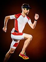 one caucasian  man runner running  triathlon ironman isolated