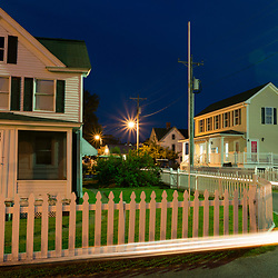 August 4, 2017 - Tangier Island, VA - The lights of a golf cart illuminate the road near new health center (far right) and an old home on Tangier Island.<br /> Photo by Susana Raab/Institute