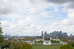 © Licensed to London News Pictures. 26/04/2019.<br /> Greenwich,UK. A view of Canary Wharf and Queens house from Greenwich Park. Cloudy but bright weather today in Greenwich Park, London as storm Hannah is set to hit the UK tonight or tomorrow with winds of up to 75mph. Photo credit: Grant Falvey/LNP