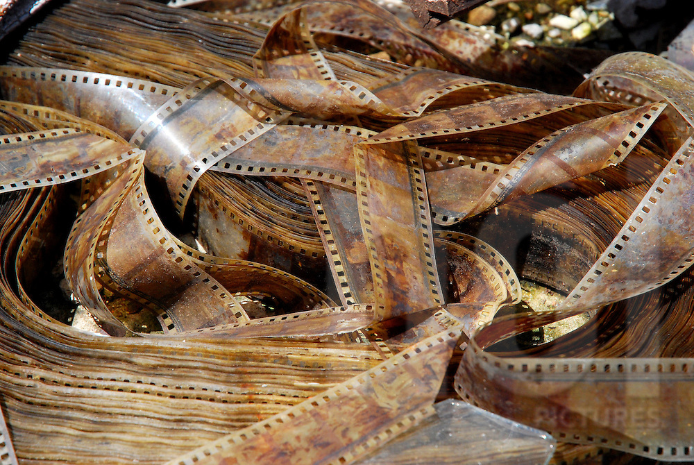 Decaying film strips from an old Chinese movie in the abandoned Bouasavanh cinema in Vientiane, Laos, Southeast Asia