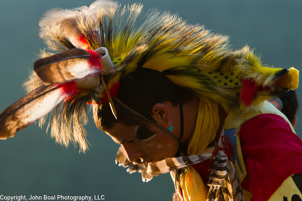 Quinton Talbott, dances as head male dancer at the annual Monacan Powwow, on Saturday, May 17, 2014.  Each dancer is expected to create their own regalia.  Because the Monacans were not federally recognized until January 2018, what might normally be eagle feathers (illegal for anyone to own outside of federally recognized tribes) is often substituted with turkey or hawk feathers.