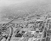 Ackroyd 10985-6. June 15, 1962. General views of area, including Banfield Freeway, I-5 Minnesota Freeway construction, inner NE neighborhood and Lloyd Center.