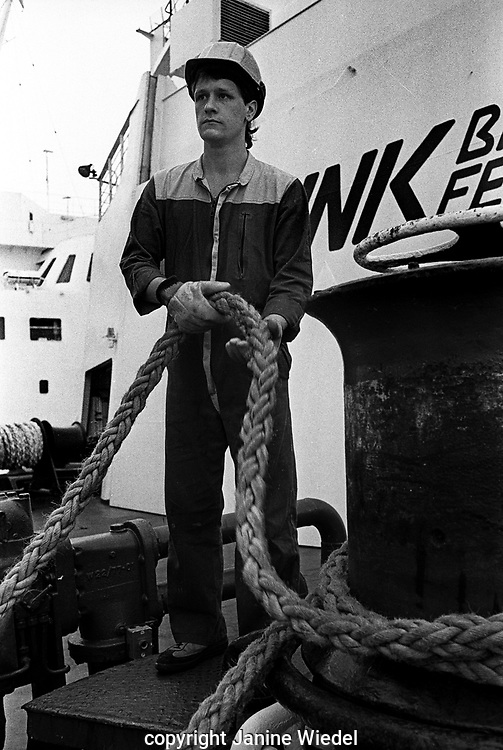Crew  winching mooring ropes  on the St Christopher Sealink cross channel British ferry in the late 1980s