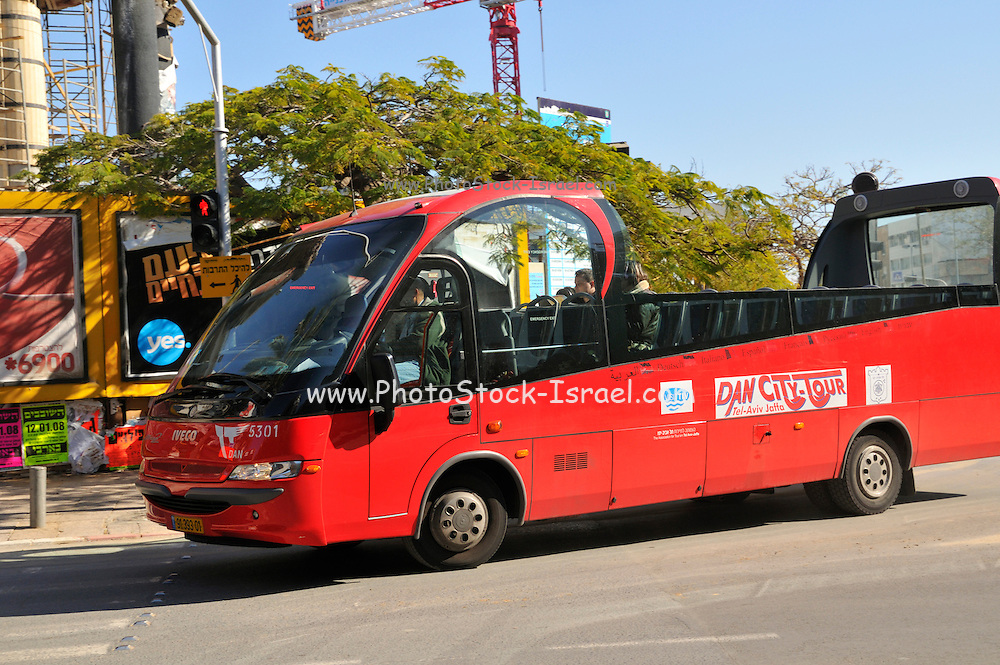 Israel, Tel Aviv a red open roof tourist bus for sightseeing the city. January 2008