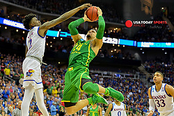 Mar 25, 2017; Kansas City, MO, USA; Oregon Ducks forward Dillon Brooks (24) goes up for a shot as Kansas Jayhawks guard Lagerald Vick (2) defends during the first half in the finals of the Midwest Regional of the 2017 NCAA Tournament at Sprint Center. Mandatory Credit: Denny Medley-USA TODAY Sports