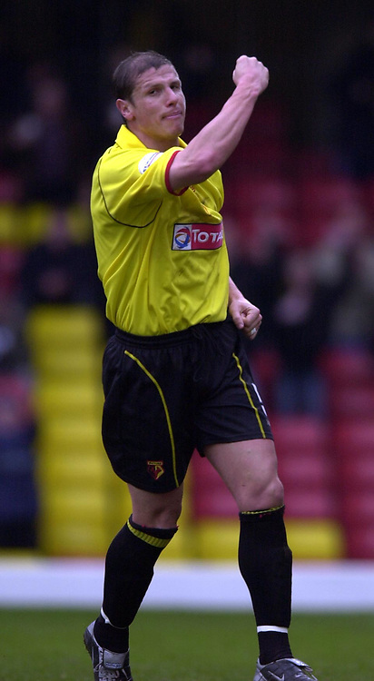 Photo. © Peter Spurrier/Sportsbeat Images<br /> 28/02/2004  -  Nationwide Div 1 Watford v Wimbledon<br /> Watford skipper Neil Cos punch's thee air after scoring Watford's second from the penalty spot