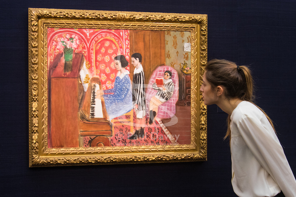 Sotheby's, London, January 28th 2016. A woman inspects Henri Matisse's La Leçon de piano from1923, expected to fetch £12 - 18 million, to be auctioned by Sotheby's in London as part of their sale of Impressionist, Modern, Surrealist and Contemporary art. ///FOR LICENCING CONTACT: paul@pauldaveycreative.co.uk TEL:+44 (0) 7966 016 296 or +44 (0) 20 8969 6875. ©2015 Paul R Davey. All rights reserved.