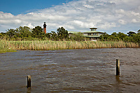 NC01372-00...NORTH CAROLINA -View of Currituck Beach Lighthouse from the boardwalk trail through the salt marsh to Currituck Sound in the town of Corrola on the Outer Banks.