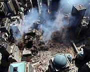Ground Zero, New York City, N.Y. (Sept. 17, 2001) -- An aerial view shows only a small portion of the crime scene where the World Trade Center collapsed following the Sept. 11 terrorist attack. Surrounding buildings were heavily damaged by the debris and massive force of the falling twin towers. Clean-up efforts are expected to continue for months. U.S. Navy photo