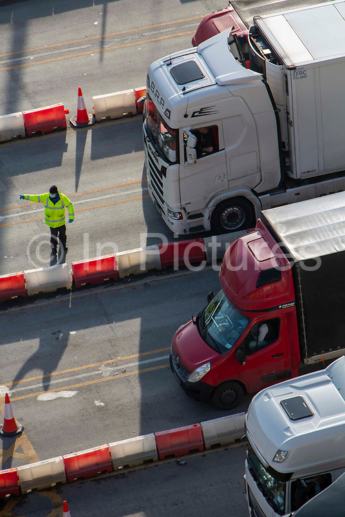 NHS test & trace underway as police and army personnel are stationed at the entrance to the departure lanes of the Port of Dover while Test & Trace administer the COVID-19 lateral flow test on the 29th of December 2020 in Dover, Kent, United Kingdom. The French border was closed due to a new strain of COVID-19, all travellers now need a negative COVID-19 test before they can board a ferry to Calais, France.