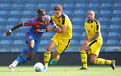 Crystal Palace's Wilfried Zaha (left) and Oxford United's Josh Ruffels battle for the ball during a pre season friendly match at The Kassam Stadium, Oxford.