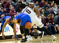 Florida guard Chris Chiozza (11) and Texas A&M guard Jay Jay Chandler (0) fight for a loose ball during the second half of an NCAA college basketball game Tuesday, Jan. 2, 2018, in College Station, Texas. (AP Photo/Sam Craft)