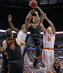 December 16, 2017 - Sunrise, FL, USA - Florida's Chris Chiozza (11) takes a rebound in the second half against Clemson during the Orange Bowl Basketball Classic at the BB&T Center in Sunrise, Fla., on Saturday, Dec. 16, 2017. Clemson won, 71-69. (Credit Image: © Al Diaz/TNS via ZUMA Wire)