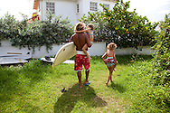 Brian Talma, surfer and all-around water man, at home on the south coast of Barbados.  Pictured here is Brian with three of his four children at Silver Sands, home to his de Action surf shop