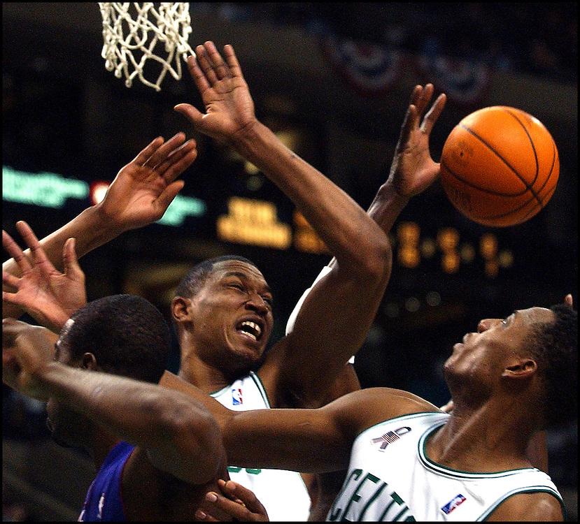(11/23/01 Boston, MA.) Boston Celtics vs Toronto Raptors.  Tony Battie and Paul Pierce battle for a second half rebound. (112301celts-Staff Photo by Michael Seamans. Saved in Photo sat.)