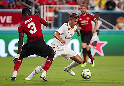July 31, 2018 - Miami Gardens, Florida, USA - Real Madrid C.F. midfielder Marcos Llorente (18) wins control of the ball over Manchester United F.C. defender Eric Bailly (3) during an International Champions Cup match between Real Madrid C.F. and Manchester United F.C. at the Hard Rock Stadium in Miami Gardens, Florida. Manchester United F.C. won the game 2-1. (Credit Image: © Mario Houben via ZUMA Wire)