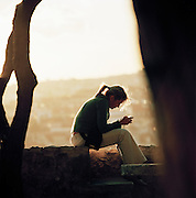 A girl on her mobile phone in Lisbon, Portugal