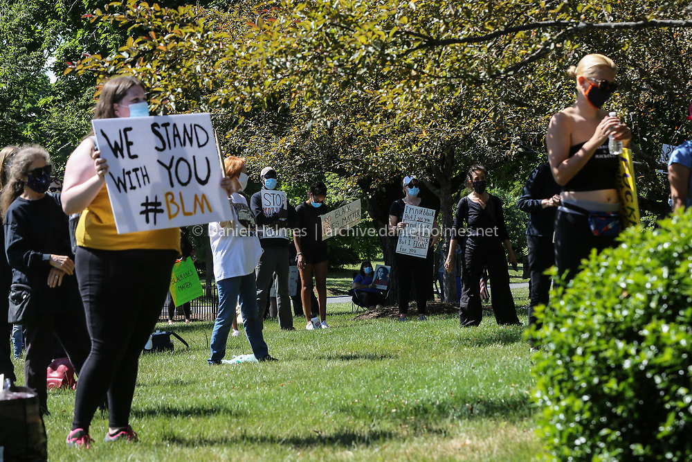 (6/14/20, FRAMINGHAM, MA) People gather with signs  during a Black Lives Matter event at Cushing Memorial Park in Framingham on Sunday. [Daily News and Wicked Local Photo/Dan Holmes]