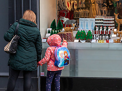 © Licensed to London News Pictures. 02/11/2020. London, UK. A girl and a women look in the window of a shop selling Christmas gifts in Richmond Town, South West London two days before another National lockdown. Prime Minister Boris Johnson announced on Saturday new Covid lockdown restrictions for England from Thursday with pubs, restaurants, non-essential shops and gyms to close. Later the Prime Minister will give a statement to the commons as he warns MPs that deaths from Covid-19's second wave could be twice as high as the first ahead of MPs voting on the Government's 4 week lockdown measures. Photo credit: Alex Lentati/LNP