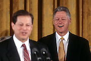 US President Bill Clinton laughs as Vice President Al Gore introduces him during an event unveiling the first balanced federal budget in the East Room of the White House February 2, 1999 in Washington, DC.