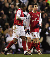 Photo: Paul Thomas.<br /> Tottenham Hotspur v Arsenal. Calring Cup, Semi Final 1st Leg. 24/01/2007.<br /> <br /> Julio Baptista (L) of Arsenal tries to tell team-mate Cesc Fabregas what happened in him scoring an own goal, but Fabregas wasn't interested!!