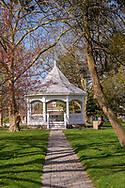 A stone path through the grass leads to the Constutition Gazebo in Potters Park in Spring Lake, NJ.