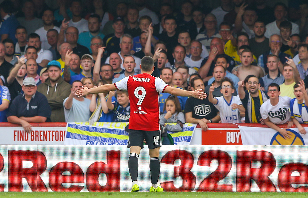 Brentford's Neal Maupay celebrates in front of Leeds United fans after opening the scoring<br /> <br /> Photographer Alex Dodd/CameraSport<br /> <br /> The EFL Sky Bet Championship - Brentford v Leeds United - Monday 22nd April 2019 - Griffin Park - Brentford<br /> <br /> World Copyright © 2019 CameraSport. All rights reserved. 43 Linden Ave. Countesthorpe. Leicester. England. LE8 5PG - Tel: +44 (0) 116 277 4147 - admin@camerasport.com - www.camerasport.com