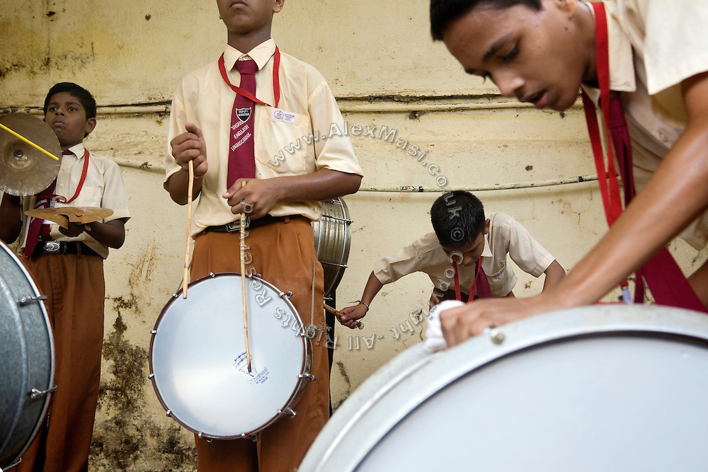 A small band is playing during the Durga Puja festival celebrations in the courtyard of a school run by the fast-growing Spanish NGO in Mumbai, India.