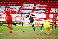 Barnsley forward Jacob Brown (33) runs away celebrating after scoring the winning goal in time added on during the EFL Sky Bet League 1 match between Walsall and Barnsley at the Banks's Stadium, Walsall, England on 23 March 2019.