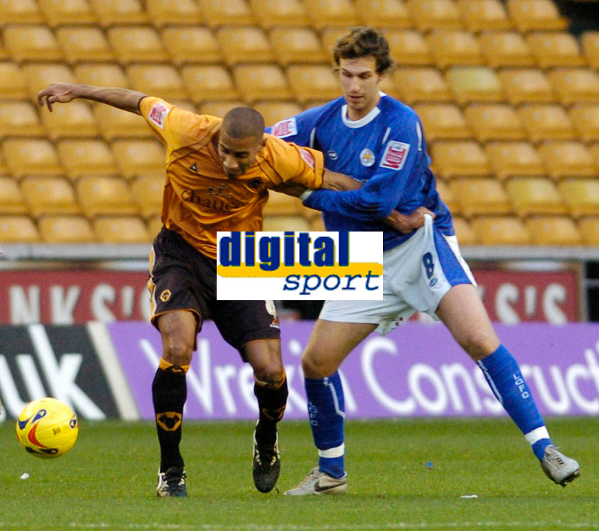 Photo: Leigh Quinnell.<br /> Wolverhampton Wanderers v Leicester City. Coca Cola Championship. 09/12/2006. Leicesters Gareth Williams keeps holds of Wolves' Karl Henry.