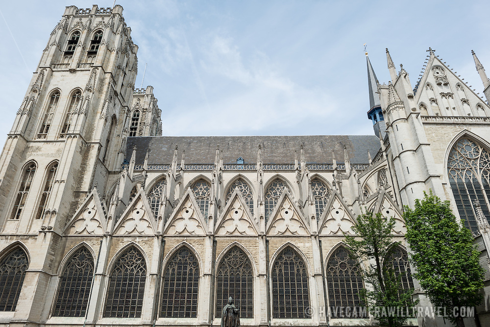 The outside of the nave at the Cathedral of St. Michael and St. Gudula (in French, Co-Cathédrale collégiale des Ss-Michel et Gudule). A church was founded on this site in the 11th century but the current building dates to the 13th to 15th centuries. The Roman Catholic cathedral is the venue for many state functions such as coronations, royal weddings, and state funerals. It has two patron saints, St Michael and St Gudula, both of whom are also the patron saints of Brussels.