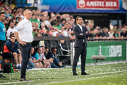 (L-R) coach John van den Brom of AZ, coach Giovanni van Bronckhorst during the Dutch Toto KNVB Cup Final match between AZ Alkmaar and Feyenoord on April 22, 2018 at the Kuip stadium in Rotterdam, The Netherlands.