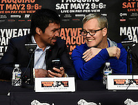 April 29.2015. Las Vegas NV. Manny Pacquiao(L) talks with his trainer Freddie Roach at the MGM grand hotel. Wednesday. Manny Pacquiao will be fighting Floyd Mayweather Jr.this Saturday May 2nd at the MGM grand hotel in Las Vegas. Photo by Gene Blevins/LA DailyNews