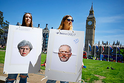 © Licensed to London News Pictures. 03/06/2017. London, UK. Students ask young people to engage with political discussions and write their opinions on card boards ahead of the next week's general election in Westminster, London on Saturday 3 June 2017. Photo credit: Tolga Akmen/LNP