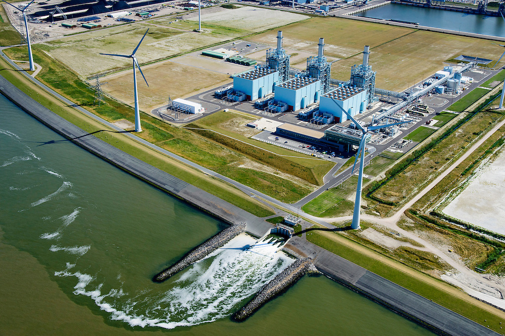 Nederland, Groningen, Eemshaven, 05-08-2014; Haven omzoomd door windmolens. Energie-landschap met elektricitieitscentrale van Nuon.<br /> Harbor area and energy landscape with wind turbines and different power plants: the Nuon (Magnum multi-fuel plant.<br /> <br /> luchtfoto (toeslag op standard tarieven);<br /> aerial photo (additional fee required);<br /> copyright foto/photo Siebe Swart