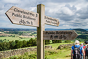Cleveland Way sign, North York Moors NP. Hike from Osmotherly to Great Broughton on the Cleveland Way Public Footpath, in North York Moors National Park, England, United Kingdom, Europe. England Coast to Coast hike day 10 of 14. Overnight at Wainstones Hotel, Great Broughton, North Yorkshire county. [This image, commissioned by Wilderness Travel, is not available to any other agency providing group travel in the UK, but may otherwise be licensable from Tom Dempsey – please inquire at PhotoSeek.com.]