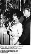 Elizabeth Taylor with her Oscar and Larry Fortensky at Swifty Lazar's last Oscar Night  Party. Spago's. Los Angeles. March 1993. Film. 93250/10<br />