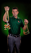 The University of Miami Hurricanes coach, Manny Diaz holds the football team's Turn Over Chains on Tuesday, August 13, 2019. <br /> The original Turnover Chain at right is 36 Inches long & weighs 5.5 pounds. The 2018 version of the chain has Sebastian the Ibis at 8.5 inches, about three inches longer than the U, and features more than 4,000 stones.