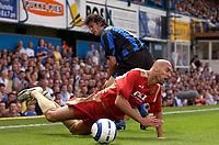 Photo: Daniel Hambury.<br /> Portsmouth v Inter Milan. Pre Season Friendly.<br /> 31/07/2005.<br /> Portsmouth's Ivica Mornar is brought down by  Inter's Santiago Solari.