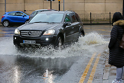 © Licensed to London News Pictures. 16/02/2020. London, UK. A car travels through the flood on Green Lanes in north London caused by heavy rain from Storm Dennis. Photo credit: Dinendra Haria/LNP