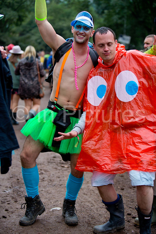 two men off their faces in the Glastonbury Festival.<br /> Glastonbury Festival is the largest greenfield festival in the world, and is now attended by around 175,000 people. It's a five-day music festival that takes place near Pilton, Somerset, England. In addition to contemporary music, the festival hosts dance, comedy, theatre, circus, cabaret, and other arts. It is organised by Michael Eavis on his own land, Worthy Farm in Pilton. Leading pop and rock artists have headlined, alongside thousands of others appearing on smaller stages and performance areas.