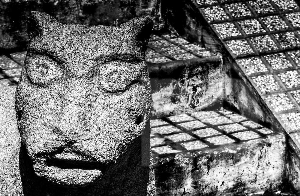 Stone carved statue along the staircase of a temple in Tao Dan Park, Ho Chi Minh City, Vietnam, Southeast Asia