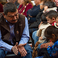 Council Delegate Tom Chee, takes a moment to play with several of the children from the Navajo head start program, during the Navajo Nation Council Fall Session, in Window Rock.