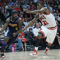 26 March 2012: Denver Nuggets point guard Ty Lawson (3) drives past Chicago Bulls guard Jimmy Butler (21) during the Denver Nuggets 108-91 victory over the Chicago Bulls at the United Center, Chicago, Illinois, USA. NOTE TO USER: User expressly acknowledges and agrees that, by downloading and or using this photograph, User is consenting to the terms and conditions of the Getty Images License Agreement. Mandatory Credit: 2012 NBAE (Photo by Chris Elise/NBAE via Getty Images)