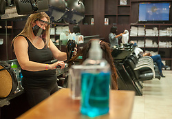 South Africa - Cape Town - 22 June 2020 - The Hair Channel in N1 City resumed business under level 3 lockdown which now permits hairdressers to be open. They wear facemasks and face covers while dealing with customers. Appointments need to be made in order to be helped. Picture Courtney Africa/African News Agency(ANA)