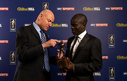Patrick Barclay of the Football Writers Association hands the Footballer of the Year award to Chelsea's N'Golo Kante during the FWA Footballer of the Year Dinner at The Landmark Hotel, London. PRESS ASSOCIATION Photo. Picture date: Thursday May 18, 2017. Photo credit should read: Steven Paston/PA Wire.